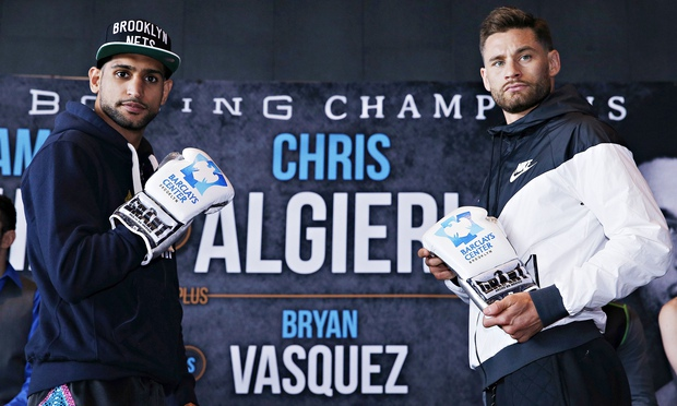 Amir Khan (left) and Chris Algieri pose for the cameras at a head-to-head press conference in Brookl